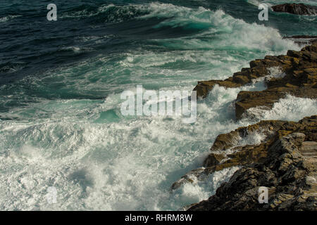 Huge Waves Crushing At The Rock Cliffs Of The Atlantic Coast In Scotland - Stock Image
