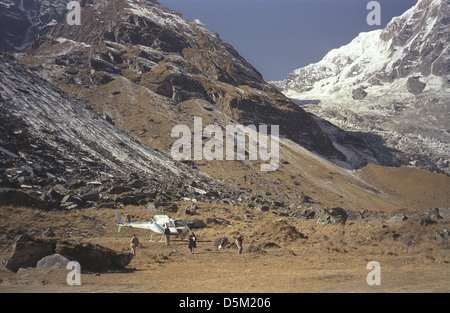 Helicopter at Annapurna Base Camp with Annapurna South on right Nepal Himalayas - Stock Image
