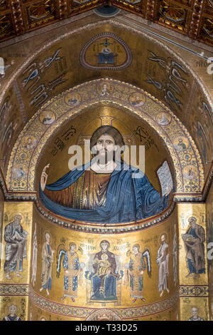 Famous mosaics and Jesus Christ Pantocrator at cathedral Basilica Cattedrale Parrocchia Santa Maria Nuova in Monreale, Sicily, Italy - Stock Image