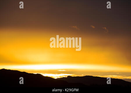 Clouds at sunset over Loughrigg in the English Lake District, UK. - Stock Image