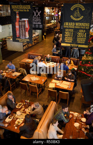 Lunchtime customers at tables in restaurant bar and brewery of Amsterdam Brewhouse restaurant at Harbourfront Toronto - Stock Image