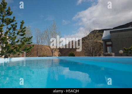 Outdoor swimming pool over-looking valley in Southern Iceland - Stock Image