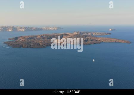 Nea Kameni volcanic island in Santorini Greece - Stock Image