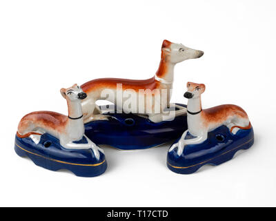 Trio of antique Staffordshire pottery inkwells or pen holders with reclining greyhounds or whippets - Stock Image