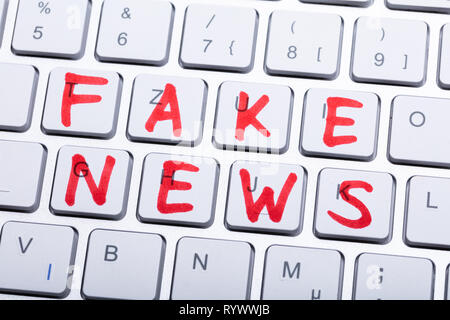 The Red Fake News Word Written On White Keyboard - Stock Image