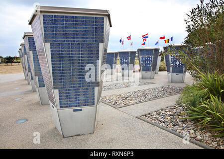 The Commemorative Bricks Memorial consists of 16 kiosks outside the Juno Beach Centre containing nearly 13,000 titanium bricks bearing the names of Canadian veterans and/or supporters of the Juno Beach Centre, Normandy, France - Stock Image