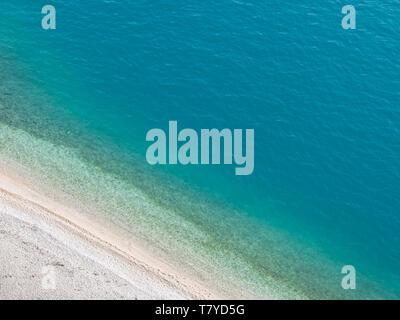 Empty famous beach Nugal and calm blue sea in Croatia aerial view - Stock Image