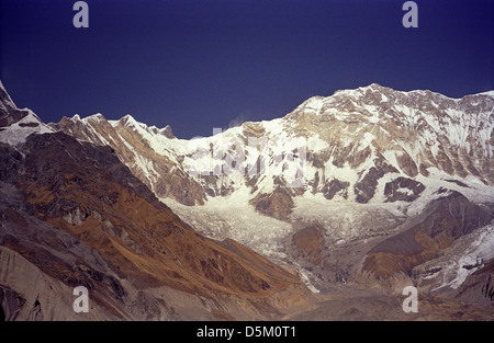 Fang 7647 metres and Annapurna I 8091 metres seen from Annapurna Base Camp with blue sky and full sunshine Nepal - Stock Image