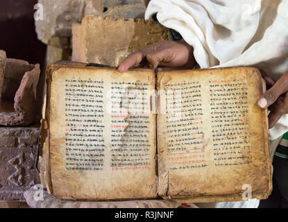Old bible book in the Great Temple of Yeha, Ethiopia - Stock Image