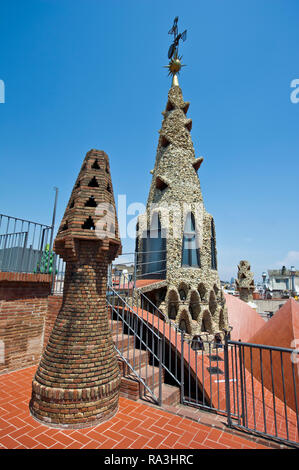 Colourful obelisks on the rooftop of the Guell Palace designed by Antoni Gaudi, Barcelona, Spain - Stock Image