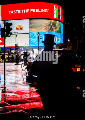 A man in a TopHat at Piccadilly Circus lights in Central London - Stock Image