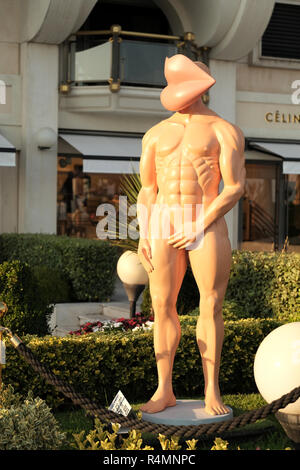 A molded sculpture by the South African artist and sculpture Richard Mas entitled Le Colosse displayed on the main boulevard in Cannes, France 2016 - Stock Image