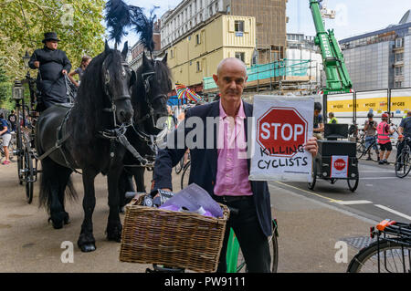 London, UK. 13th October 2018. Donnachadh McCarthy of Stop Killing Cyclists at the start  of the funeral procession of cyclists behind a horse-drawn hearse to highlight the failure of governments from all the major parties to take comprehensive action on safer cycling. Stop Killing Cyclists call for £3 billion a year to be invested in a national protected cycling network and for urgent action to reduce the toxic air pollution from diesel and petrol vehicles which kills tens of thousands of people every year, and disables hundreds of thousands. The several hundred protesters staged a ten-minute - Stock Image