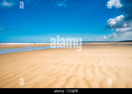 Ripples in the sand caused by the tidal movement of the sea on Holkham bay beach, North Norfolk coast, East Anglia, England, UK. - Stock Image