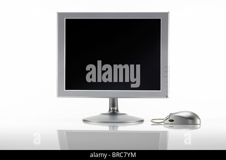 Silver LCD monitor with mouse - Stock Image
