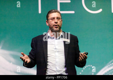 Professor Nick Colosimo of BAE Systems talking about what advances in augmented reality could mean for the next generation of combat aircraft, on the Technology Stage, at New Scientist Live - Stock Image
