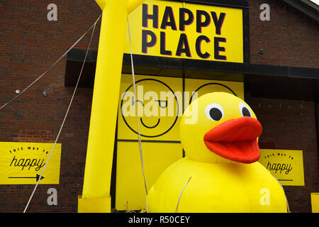 Giant inflatable yellow rubber duck at Happy Place pop-up interactive art installation at Toronto Harbourfront Centre - Stock Image