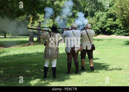 A Musket firing demonstration at Guilford Courthouse National Military Park. - Stock Image