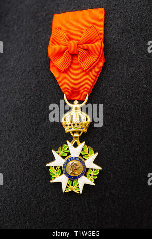 MOSCOW, AUGUST 22, 2018. Napoleon era Order of the Legion of Honor hangs on a red ribbon on a French army uniform during International Times and Epoch - Stock Image