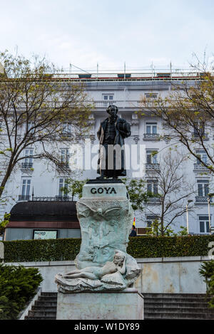 Madrid, Spain - April 14, 2019: Statue of Goya in the entrance to Prado Museum in Madrid at sunset. It is the main Spanish national art museum - Stock Image