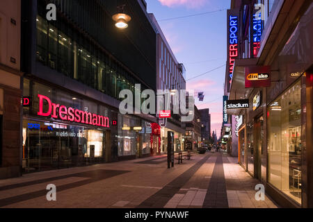 Modern shops on Drottninggatan street at sunrise, Norrmalm, Stockholm, Sweden. - Stock Image