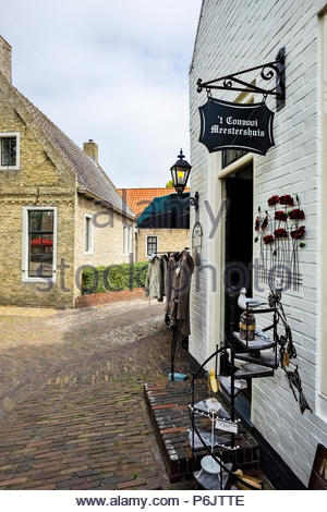 This museum and gallery on the central market square in Bourtange, the star-shaped fortress in The Netherlands, doubles as a clothing boutique. - Stock Image