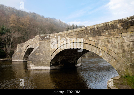 16th century stone arched bridge across River Eamont in Lake District National Park, Pooley Bridge Cumbria England UK Britain - Stock Image