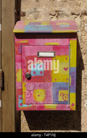 Multicoloured decorated letterbox - Stock Image
