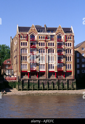 Olivers Warf on the North bank of the River Thames Below Tower Bridge and The City of Ramsgate Public House Wapping High Street - Stock Image