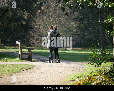 Two young ladies chatting in the park - Stock Image
