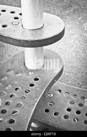 Metal steps in a playground as an abstract image - Stock Image