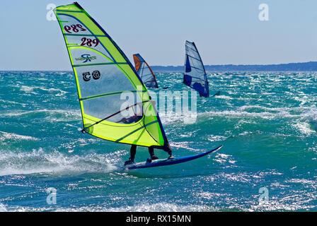 Windsurferx during a strong Mistral day in mediterranean sea (St Laurent du Var , France) - Stock Image