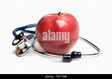 Apple and stethoscope on white background, healthy eating and lifestyle concept - Stock Image