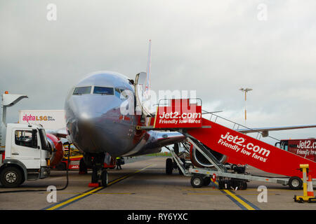 Jet2 Boeing 737 8K5 'Vienna' Airliner awaiting turn around on the apron at East Midlands Airport, Castle Donington, Derbyshire,  England. - Stock Image