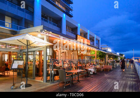 Ochre restaurant in the Marina in the evening, Cairns Wharf, Far North Queensland, FNQ, QLD, Australia - Stock Image