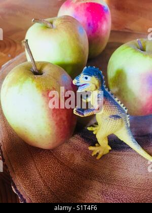 Godzilla eats an apple - Stock Image