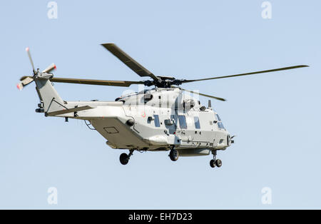 NH Industries (Airbus) NH-90 military helicopter of the Italian Navy in flight with clear sky. - Stock Image