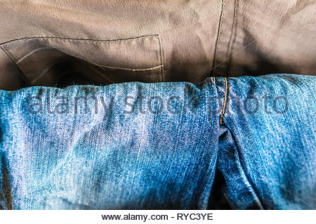 Close up of a hanging blue jeans pants. - Stock Image