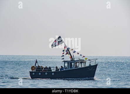 Mousehole, Cornwall, UK. 29th Mar, 2019. UK Weather. The first trip boat of the season bringing people back to Mousehole. Credit: Simon Maycock/Alamy Live News - Stock Image
