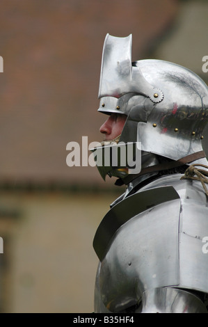 Knight in armour and helmet - Stock Image