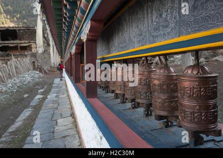 Tibetan prayer wheels or prayer's rolls of the faithful Buddhists. Horizontal photo - Stock Image