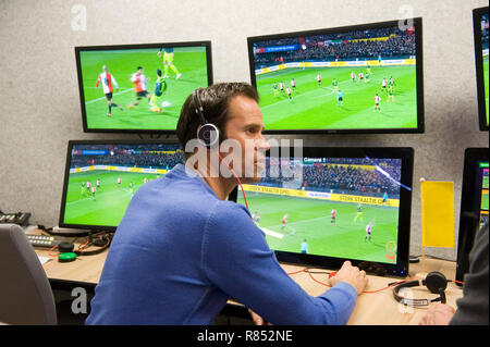 VAR referee Bas Nijhuis working at the VAR center in the headquarters of the Dutch football association. - Stock Image