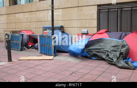 Brighton, UK. 12th Mar, 2019. Homeless tents get blown around just off Brighton seafront as Storm Gareth arrives in Britain and Ireland with wind speeds forecast to reach up to 70 mph in some areas Credit: Simon Dack/Alamy Live News - Stock Image