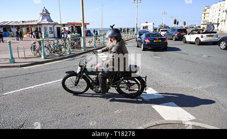 Brighton, UK. 24th March 2019. An entrant leans into the final corner on Brighton seafront in the 80th Anniversary Pioneer Run for pre 2015 veteran motorcycles . The run organised by the Sunbeam Motor Cycle Club begins on the Epsom Downs in Surrey and finishes on Madeira Drive on Brighton seafront Credit: Simon Dack/Alamy Live News - Stock Image