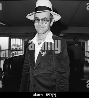 Elton John leaves Heathrow Airport. He is going to Los Angeles for the party of Elton John's Manager.  Picture taken 9th September 1974 - Stock Image