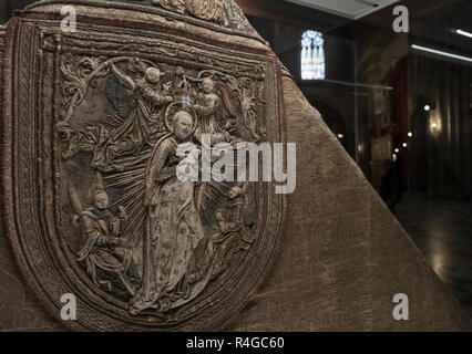 Closeup detail of religious embroidery work displayed inside Seville cathedral, a UNESCO world heritage site, Seville, Andalucia, Spain. - Stock Image