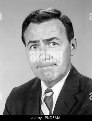 1960s BUSINESSMAN WITH PURSED LIPS HELD TIGHTLY SHUT FUNNY FACIAL EXPRESSION  - p7111 HAR001 HARS HEAD AND SHOULDERS HELD MUM FED UP PURSED FRUSTRATION SILENT SHUT TIGHTLY EMOTION EMOTIONAL EMOTIONS MID-ADULT MID-ADULT MAN BLACK AND WHITE CAUCASIAN ETHNICITY HAR001 OLD FASHIONED - Stock Image