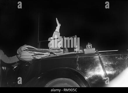 President Franklin Roosevelt waves from the back seat of limo, ca. 1944. - Stock Image