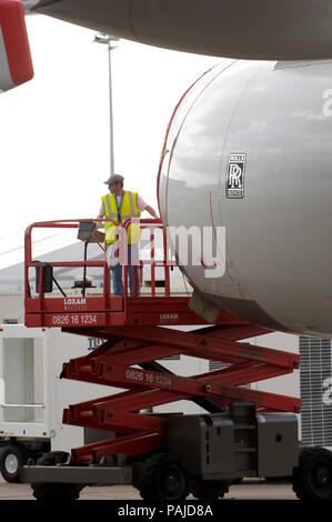 engineers on a cherry-picker inspecting the A380 Rolls-Royce Trent 970 engine at the 2005 Paris AirShow, Salon-du-Bourget - Stock Image