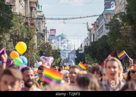 BELGRADE, SERBIA - SEPTEMBER 16, 2018:  Crowd raising and holding rainbow gay flags, in front of the serbian orthodox church of Saint Sava (Hram sveto - Stock Image